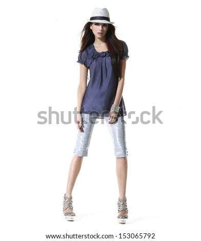 Full body Young casual woman style isolated wearing a hat standing in studio - stock photo