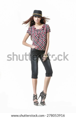 Full body young girl in hat posing - stock photo
