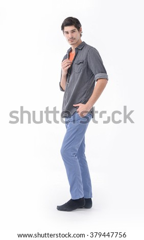 Full body Young mal model in jeans with hat posing in the studio