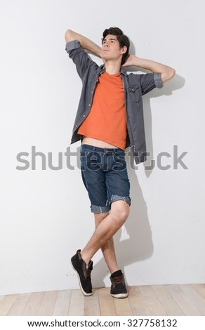 Full body Young mal model posing in the studio - stock photo
