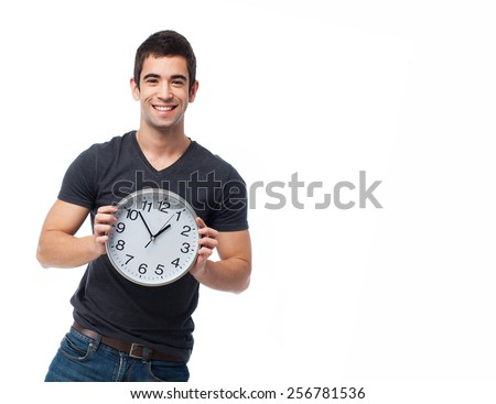 full body young man holding a clock over white