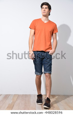 Full body young Man in Casual Clothes in wooden floor
