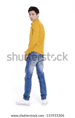 Full body young man in jeans posing back - stock photo