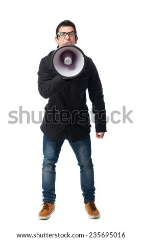 full body young man shouting with megaphone - stock photo