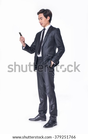 Full body young smile businessman with mobile phone