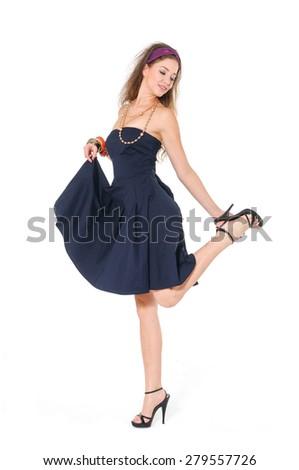Full body young woman in black dress posing  - stock photo