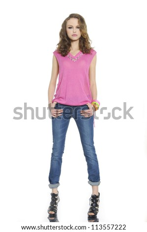 Full body young woman in casual clothes posing for the camera over white background - stock photo