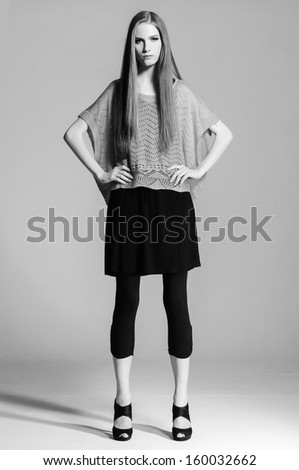Full body young woman with long hairs posing - black and white