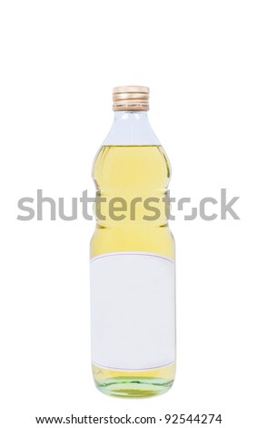 Full bottle of oil isolated close up - stock photo