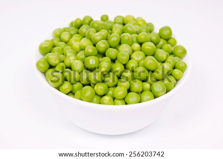 Full bowl of green beans of peas isolated on white background