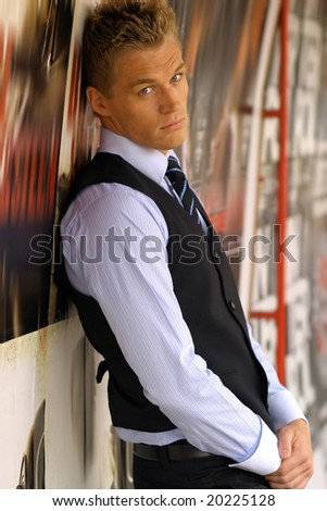 Full boyd portrait of young male model in tie and vest - stock photo