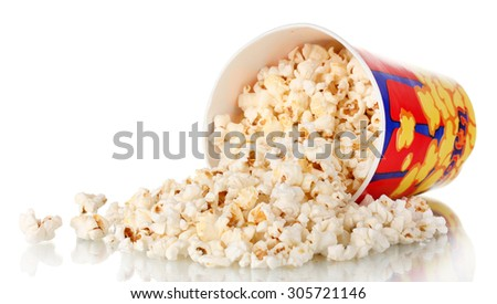 Full bucket of popcorn dropped isolated on white - stock photo