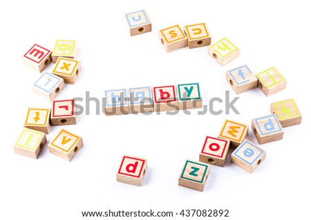 Full color Wooden toy blocks deployed baby on white background - stock photo