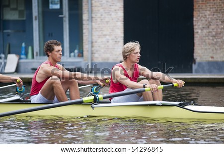 Full concentration on the faces of oarsmen before the start of a regatta - stock photo