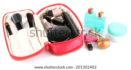 Full cosmetic bag isolated on white - stock photo