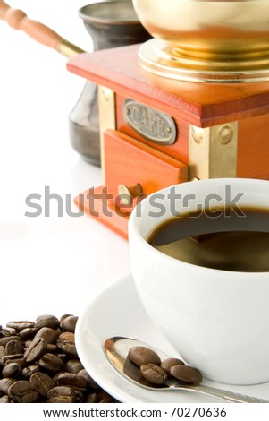 full cup of coffee, grinder and pot on beans isolated on white - stock photo