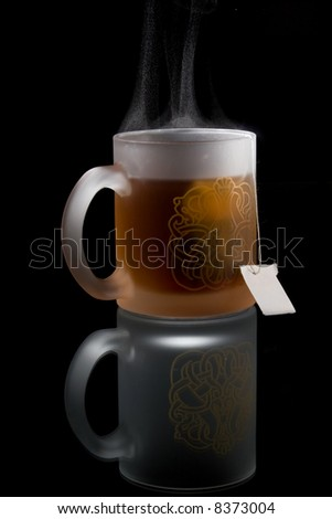 Full cup of tea - memory - stock photo