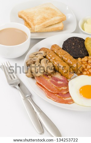 Full English Breakfast - Traditional English fry-up with egg, bacon, mushrooms, tomatoes, sausages, black pudding, hash browns and baked beans. Served with slices of toast and a cup of tea.