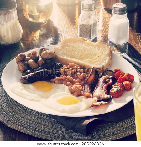 full english breakfast with instagram filter and entire image in focus - stock photo