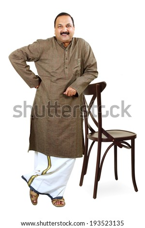 Full Figure Of Traditional Indian Young Man Hand Holding On Chair