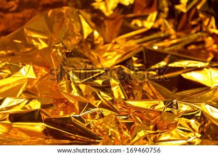 full frame creased gold foil background - stock photo