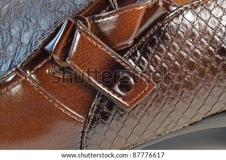 full frame detail of a brown leather shoe - stock photo