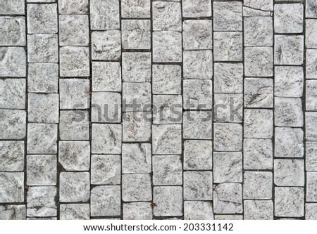 full frame detail of grey cobblestones - stock photo