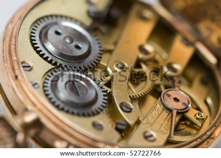 Full frame image of the clockwork of a pocket watch.