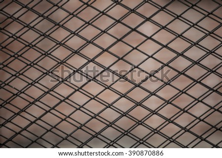 Full frame of wire mesh fence.