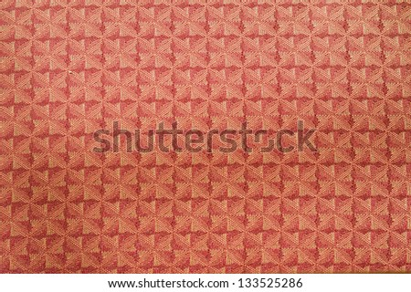 Full frame picture of pattern on red rug - stock photo