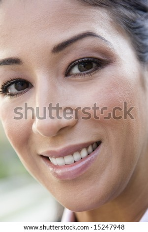 Full frame portrait of woman smiling to  camera - stock photo