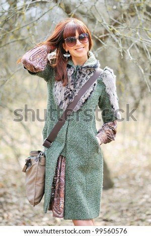 Full-frame woman wearing sunglasses outdoors - stock photo