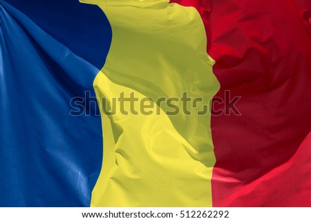 full framed romanian flag floating in the wind exact colors