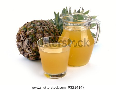 Full glass and jug of pineapple juice on a white - stock photo