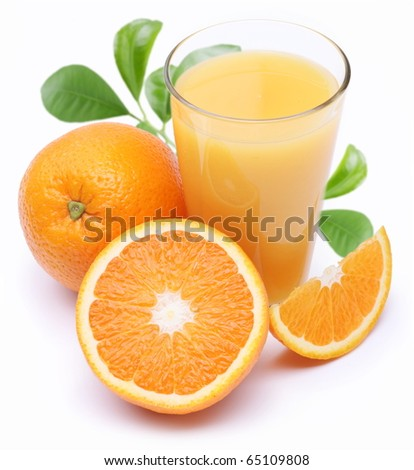 Full glass of fresh orange juice and fruit slices near it. Isolated on a white.