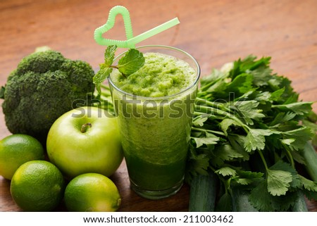 Full glass of healthy green smoothie - stock photo