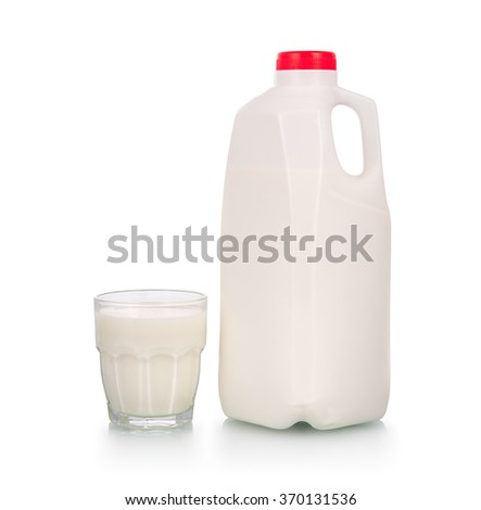 Full glass of milk by plastic bottle with red cap on white background - stock photo