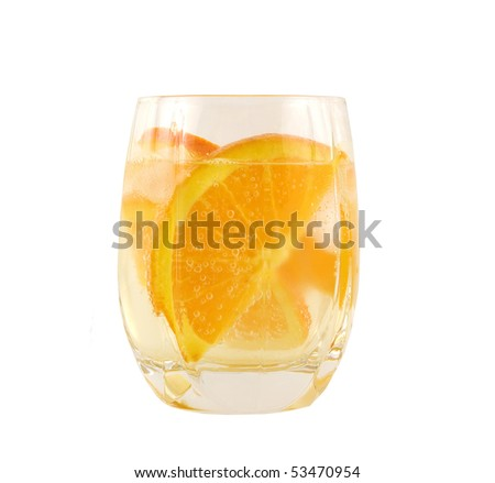 full glass of sparkling water with orange slices - stock photo