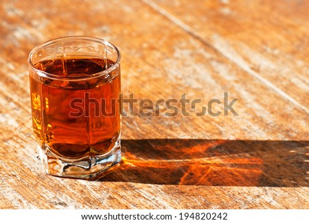 full glass of whiskey on the table - stock photo