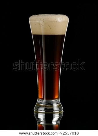 Full glass with dark beer