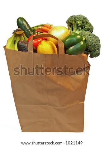 full grocery bag with fruits and vegetables - stock photo