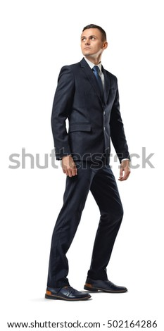 Full growth portrait of a businessman looking backwards isolated on a white background. Leaving something in the past. Going away. Turning back. Remembering something.