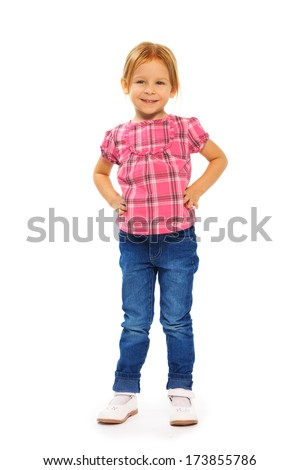 Full height portrait of happy girl in pink shirt standing isolated on white - stock photo