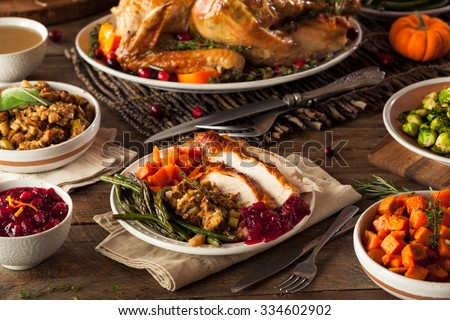 Full Homemade Thanksgiving Dinner with Turkey Stuffing Veggies and Potatos - stock photo