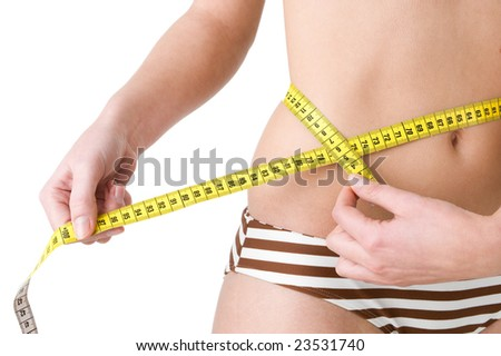 Full isolated bodypart from a caucasian woman with a measuring tape - stock photo