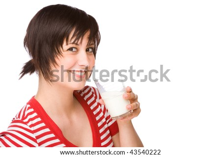 Full isolated portrait of a beautiful caucasian woman with a glass of milk - stock photo