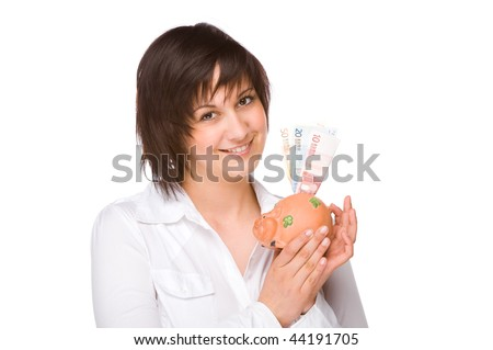 Full isolated portrait of a beautiful caucasian woman with a piggybank - stock photo