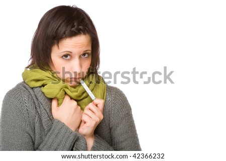 Full isolated portrait of a beautiful caucasian woman with clinical thermometer - stock photo