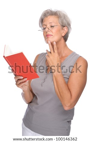 Full isolated portrait of a senior woman with red book