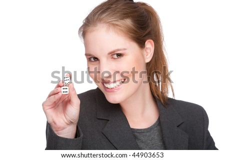 Full isolated studio picture from a young and beautiful business woman with two cubes (dice)